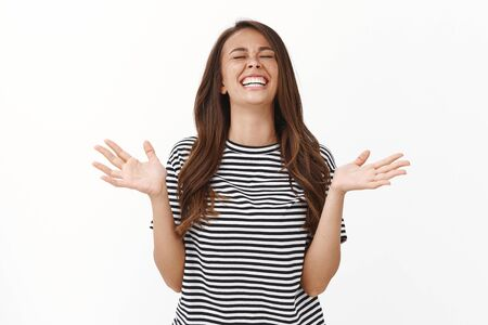 Girl thank god for winning, feeling happy received unbelievable fantastic news, Relieved joyful enthusiastic woman raising head up, close eyes and smiling, lift hands up thankful, winning lottery