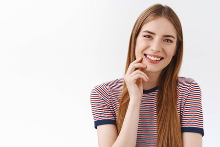 Close-up tender, feminine young happy girl in striped t-shirt, long chestnut hair, smiling toothy, tilt head entertained, touch cheek slightly with cute gaze, having pleasant conversation