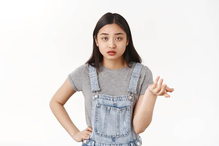 Reluctant brunette asian girlfriend shrugging raise hand full disbelief dismay questioned look camera cannot understand why boyfriend complain stand puzzled white background