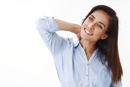 Carefree relaxed tender ambitious brunette middle-aged woman, stretching joyfully, finish work glad come home, tilt head, massaging neck, smiling, contemplate left copyspace, white background
