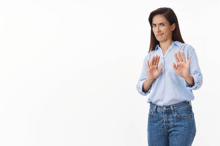 Gosh take it away. Reluctant bothered brunette middle-aged woman tilt away, raise hands refusal, rejection block gesture, smirk aversion dislike, grimacing displeased, irritated strange proposal