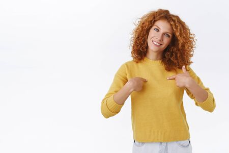Cheerful attractive caucasian redhead curly woman in yellow sweater, showing thumbs-up in support, approval, tilt head and smiling, nod agreement, give positive reply, accept plan, white background
