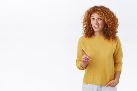 Unsure, redhead girl give advice, warn you something is not really good, shaking index finger and grimacing hesitant, have suggestion or worry, saying her opinion, judging awkward situation