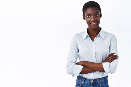 Business, women and company concept. Waist-up portrait of smiling african-american lady boss, hold hands crossed over chest and looking camera confident, dealing with work, being professional