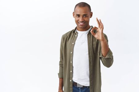 Portrait of young african-american determined man, guarantee good quality, assure client invest in company, join team of professionals, smiling self-assured, recommend product