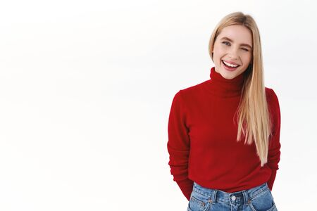 Work, career and lifestyle concept. Lucky good-looking blonde woman in red turtleneck wink, encouraging apply your resume, join team or company, smiling happy, standing white background