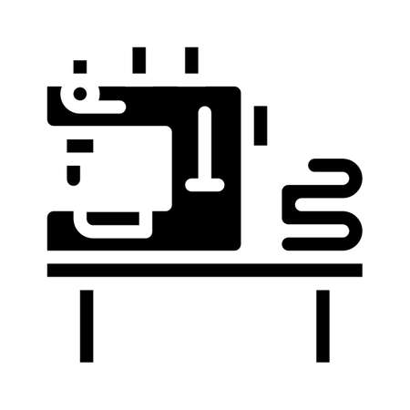 table with typewriter and fabrics glyph icon vector illustration