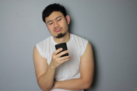 A man get bad news from mobile phone.