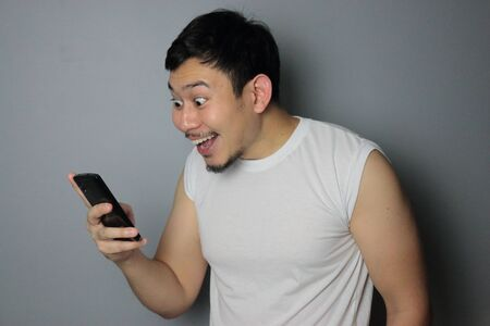 A man get good news from mobile phone. 写真素材