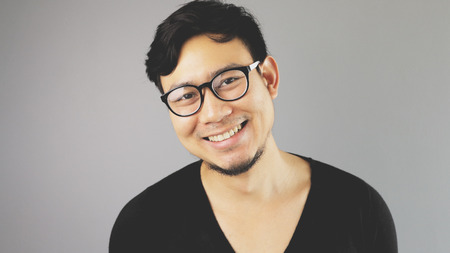 A smiling man with black tshirt.