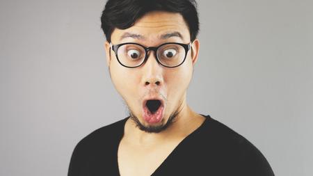 WOW face of Asian man.