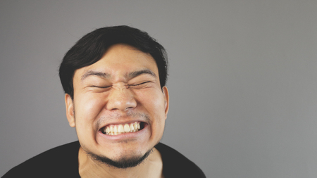 Happy smiling Asian man.