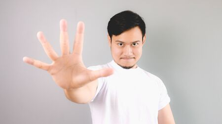 Five hands signs with confident face. An asian man with white t-shirt and grey background.