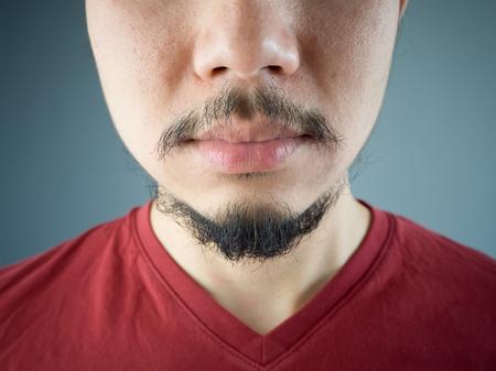stylish man: Close up of Asian man mustache and beard.