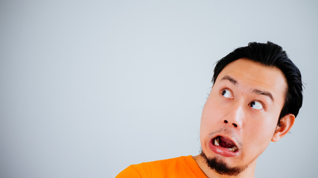 Shocked and surprised face of Asian man with Velvia filter. 스톡 콘텐츠