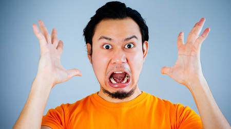 Shocked and surprised face of Asian man with Velvia filter. Stock Photo