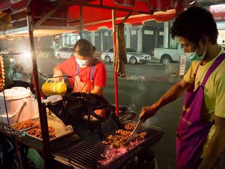 isaan: BANGKOKTHAILAND - Novenber 13 2015: Ordinary Thai woman is selling night street food, Isaan sausage.