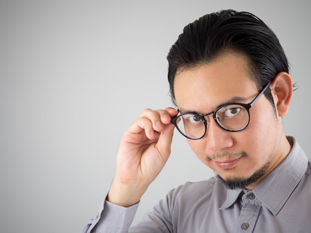 Confidence Asian businessman in gray shirt.