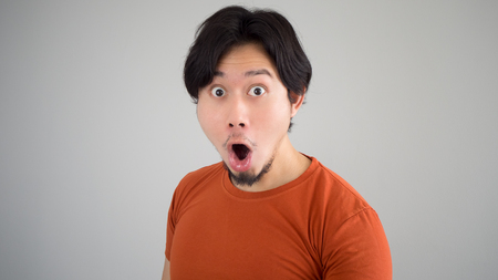 Surprised Asian man in red t-shirt.