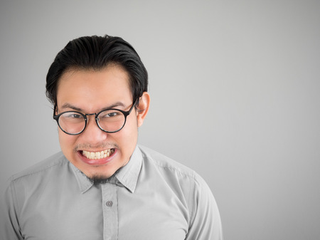 glad: Glad Asian businessman with a big smile. Stock Photo