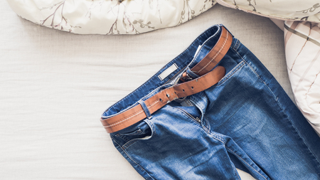 clam beds: Man outfit laid on bed in the morning light. Stock Photo