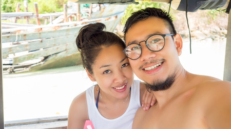 taking a wife: Asian lover on Thai longtail boat.