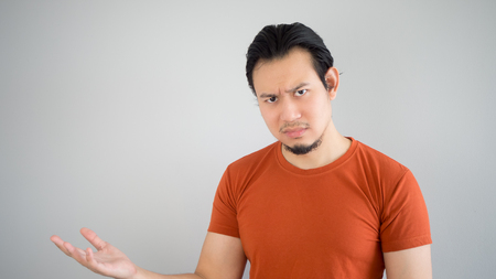 Disappointed Asian man in red T-shirt.