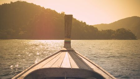 long tailed boat: Long tailed boat tour around Thailand Islands in sunset.