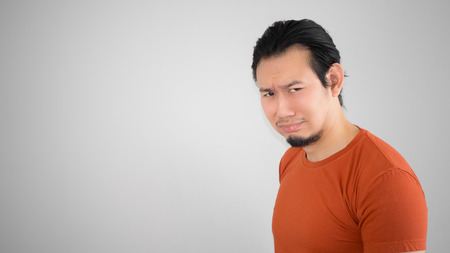 red tshirt: Crying Asian man in red tshirt. Stock Photo
