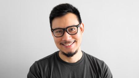 Happy Asian man with eyeglasses. Archivio Fotografico