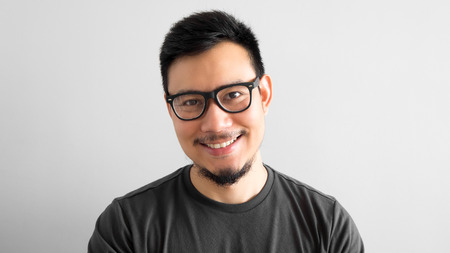 Happy Asian man with eyeglasses. Stok Fotoğraf