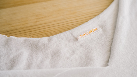 gold table cloth: Diy tailoring your own t-shirt. Stock Photo