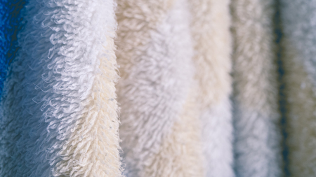white towel: Close up of hanging towels in bathroom. Stock Photo
