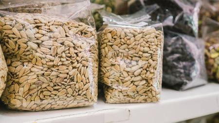 protien: Plastic bag of almonds in bakery shop.