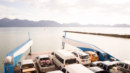 Ferry boat is carrying cars to Koh Chang, Thailand.