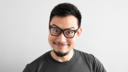 Happy Asian man with eyeglasses. Stock Photo