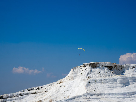 PAMUKKALE, DENIZLI, TURKEY - SEPTEMBER 14 2016: Pamukkale, meaning cotton castle in Turkish, is a natural site in Denizli Province in southwestern Turkey. The city contains hot springs and travertines.