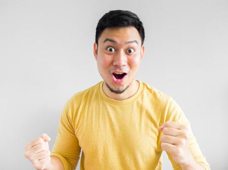 Happy Asian man face in yellow shirt.