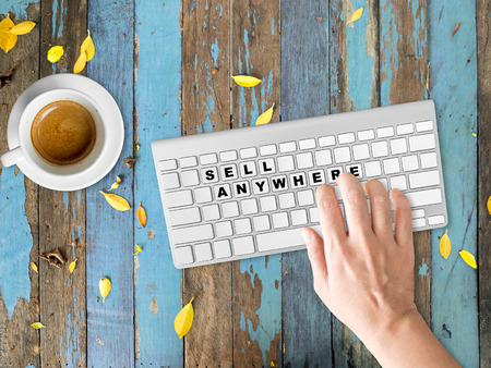 Concept of Sell Anywhere words on buttons of keyboards. Stock Photo