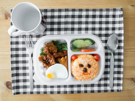 Cute lunch box set decorated as smile bear face. 写真素材