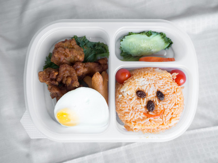 Cute lunch box set decorated as smile bear face. Stok Fotoğraf