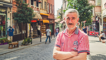 turkish man: Istanbul, Turkey - September 11, 2016: 50s Turkish man stand in the colorful city of Istanbul. Editorial