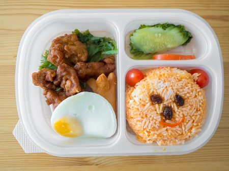 Cute lunch box set decorated as smile bear face. Archivio Fotografico