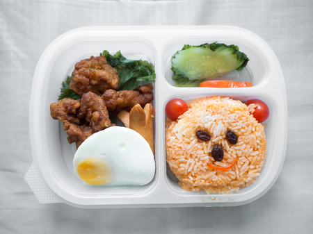 Cute lunch box set decorated as smile bear face. Stock Photo