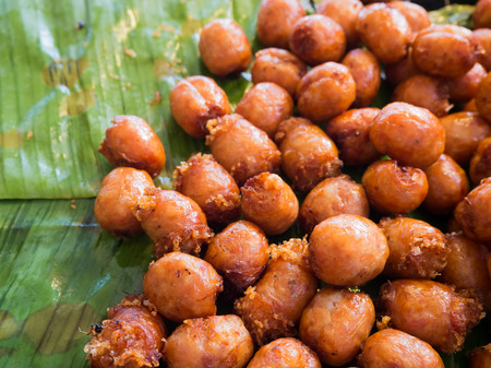Close up of Thai Isaan sausages cut into balls.