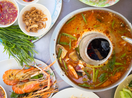 favorite soup: Top view of traditional Thai spicy food. Fried rice. Tom yum koong soup. Grilled shrimps.