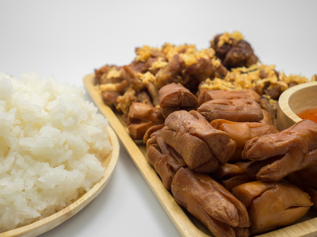 Set of sticky rice and fried chicken on white background. Stock Photo