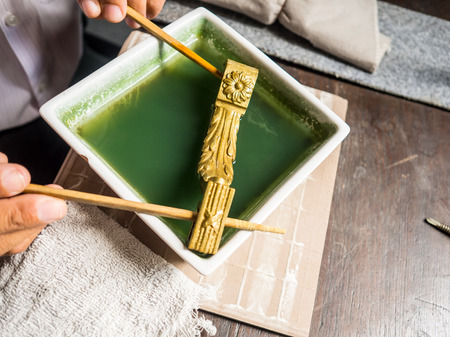 professionally: Bangkok, Thailand - August 30, 2016: Tradition gold cleaning workshop. Stock Photo