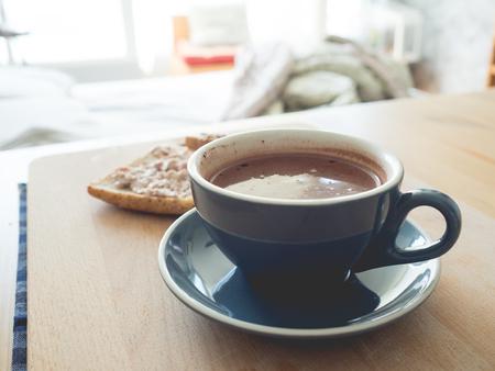 tuna mayo: Coffee and tuna sandwiches breakfast set on wooden table.