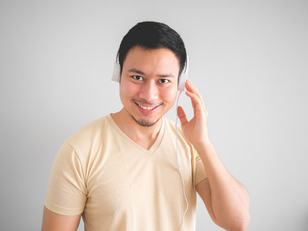 Asian man is relaxing by listening to happy music. Stock Photo